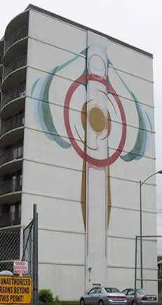 mural of abstract art painted high on apartment tower