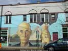 mural of Grant Wood's American Gothic with woman upside down