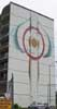 Abstract painting on side of tall building